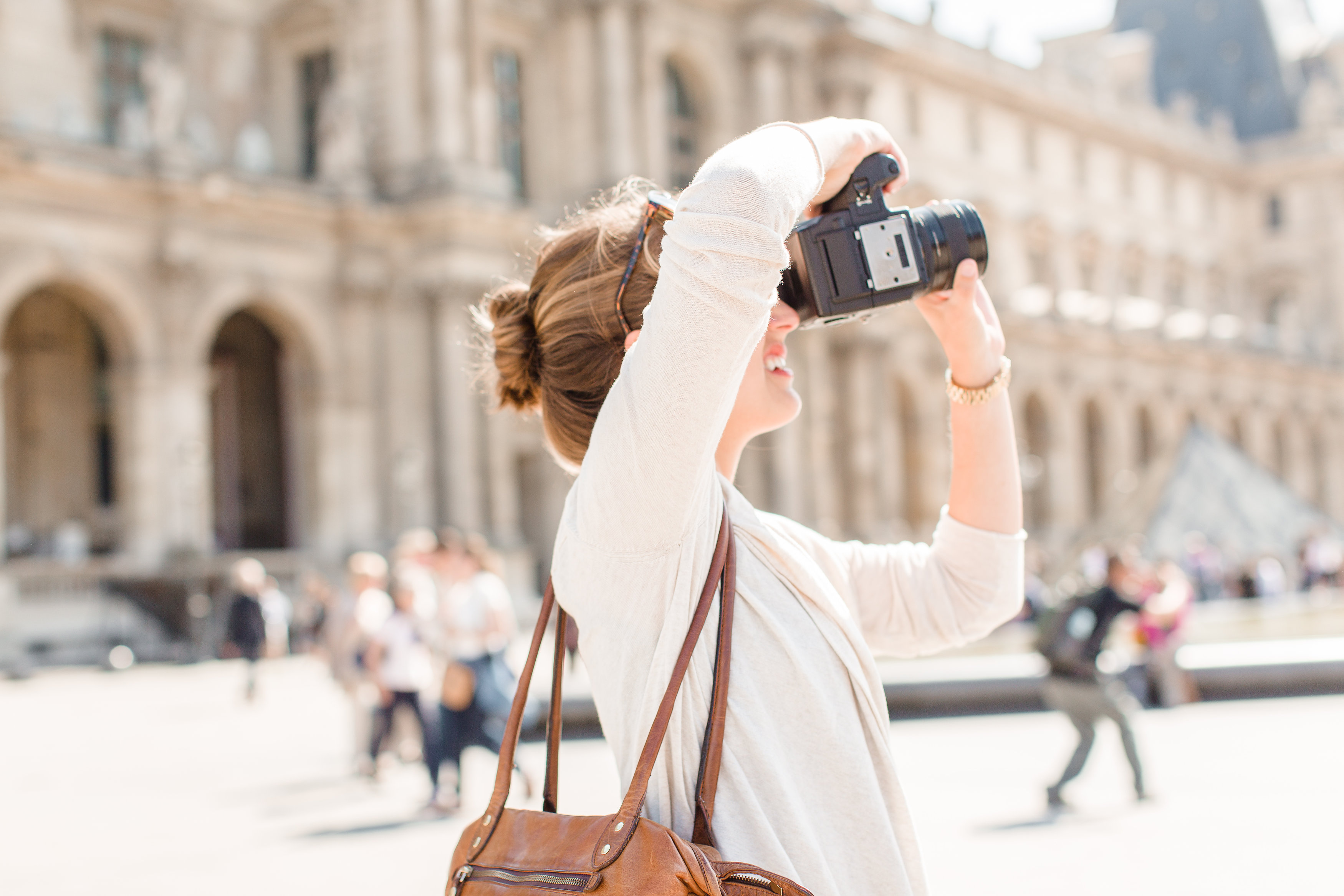 12 Girl taking photo in front of Lourvre Paris by Anna K Photography