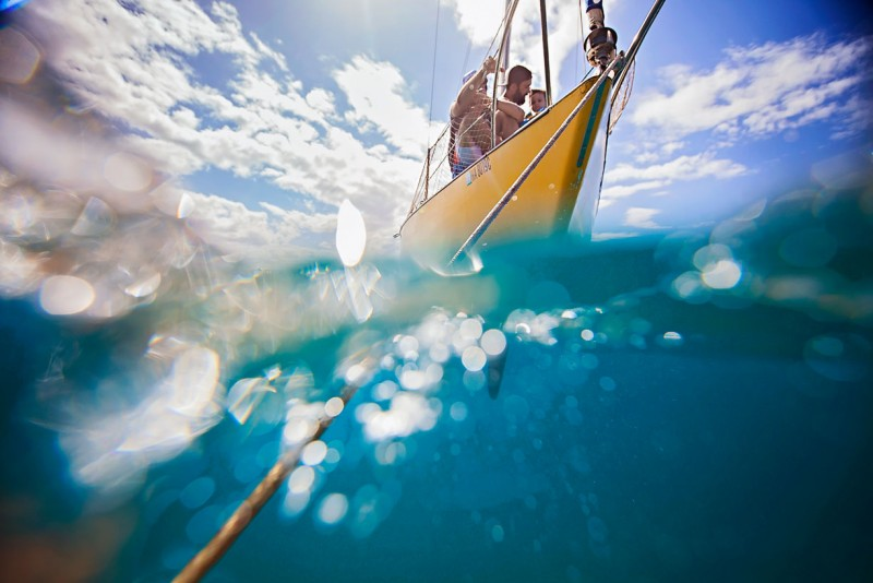 14 Partial underwater photo of sailboat moored in ocean under sunny sky by-Three-Plus-Photography