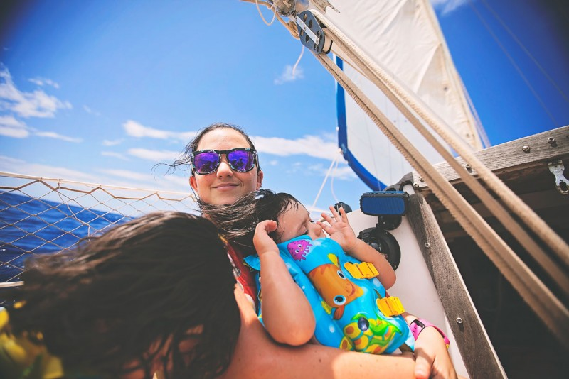 5 Photo of children and adult on sailboat by-Three-Plus-Photography