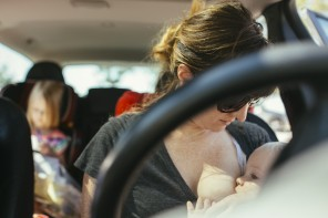 Image of mother nursing in driver's seat of car by amanda voelker