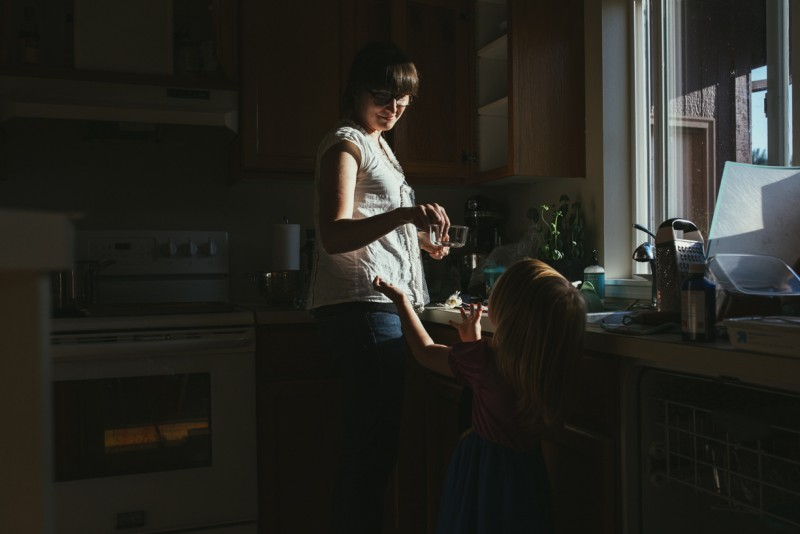 photo of mother hand child clean dish in kitchen by Amanda Voelker