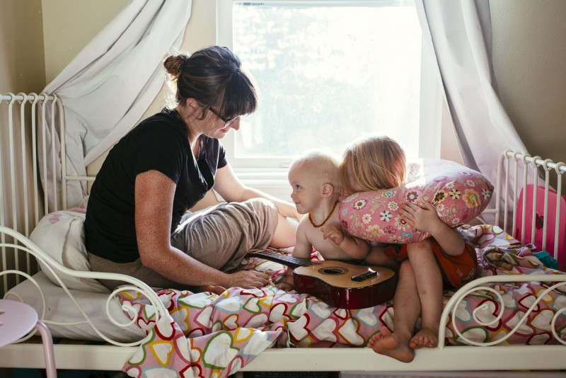 picture of mother two children on toddler bed with guitar by amanda voelker