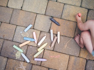 picture of toddler in diaper sidewalk chalk dirty feet from above by Elizabeth Clark Photography