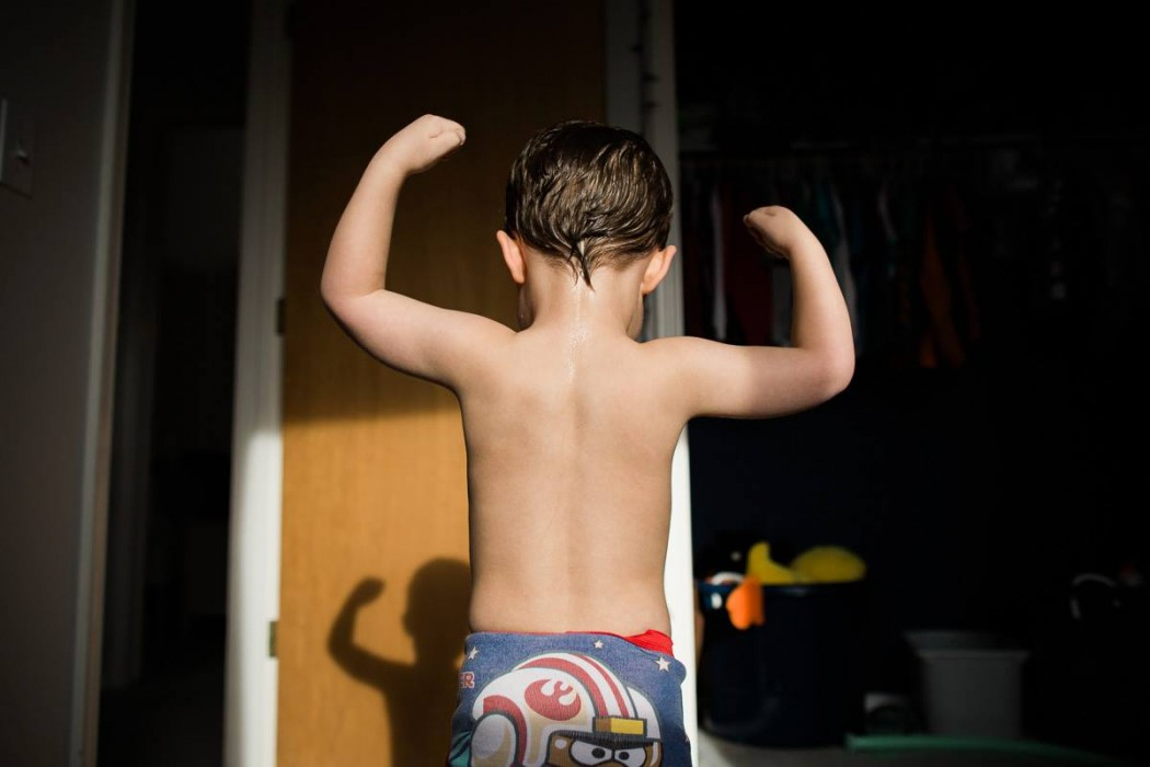 Image of young boy in underwear showing muscles by Jo Lien