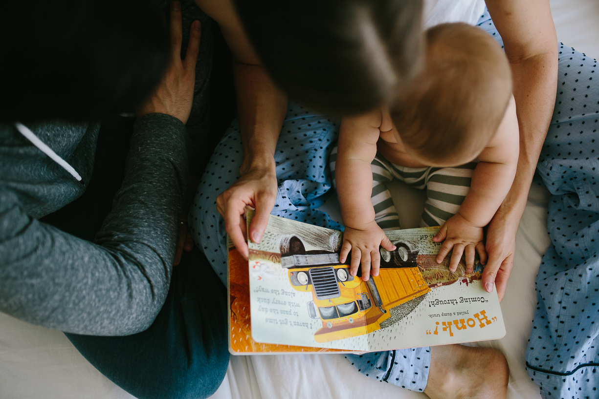 a photo of a family reading a book together by chicago photographer Katie Kett