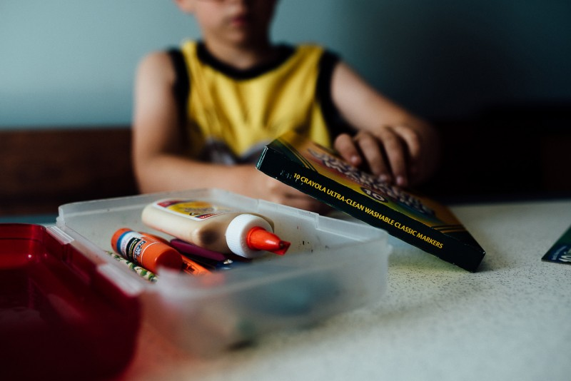 image of faceless boy with school supplies by Mindy Sauvageau