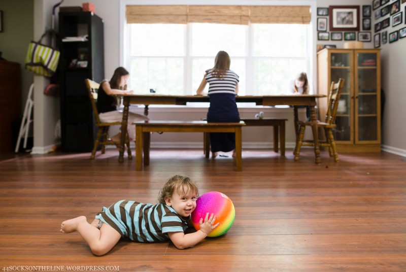 picture of boy with ball and sister homeschool in background by sarah hodges