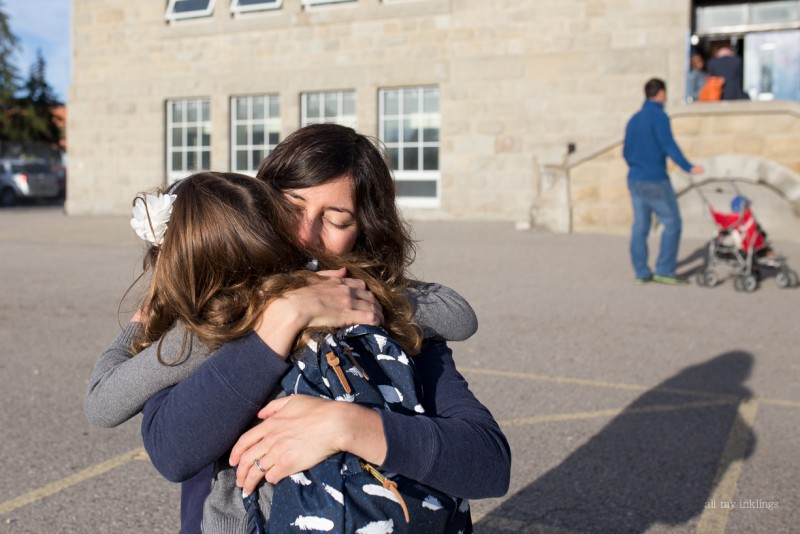 picture of mother hugging daughter on first day of school by alison myers