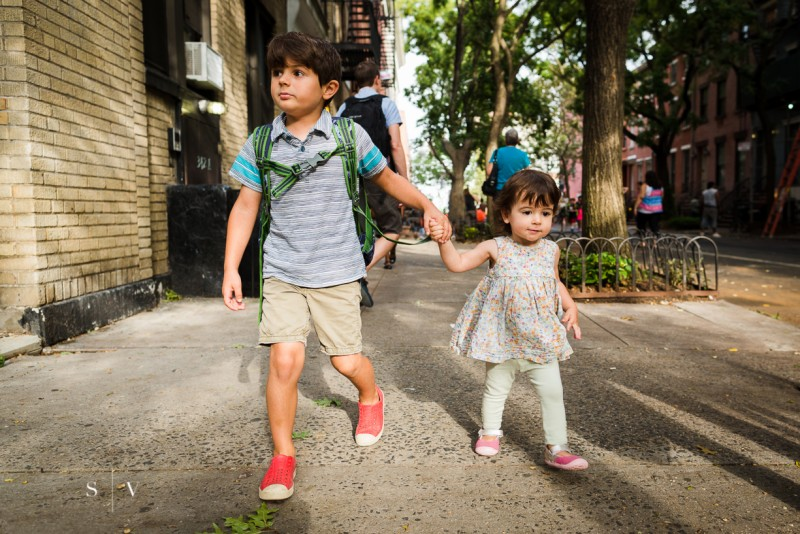 picture of young boy holding sister hand walking to school new york city by stacey vukelj