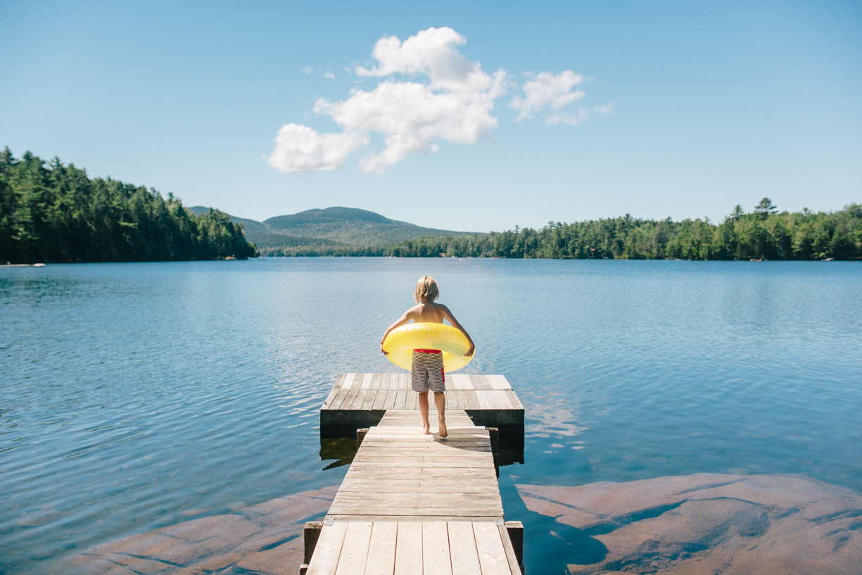 1 Boy with intertube on a maine lake picture by cate wnek photography