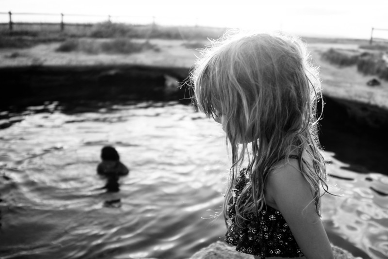 Backlit-girl-in-front-of-Utah-swimming-hole-photo-by-Summer-Murdock