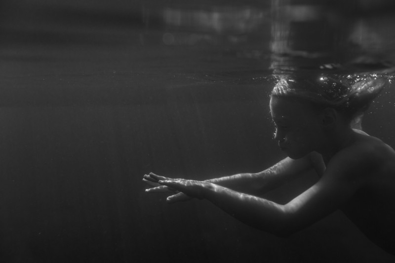 12 Boy swims underwater in B&W picture by cate wnek photography