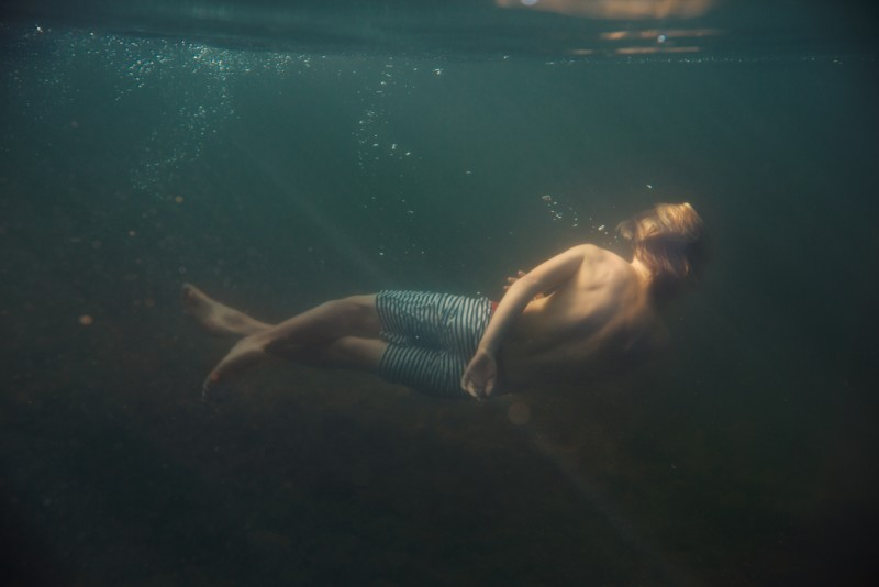 14 boy swims underwater picture by cate wnek photography