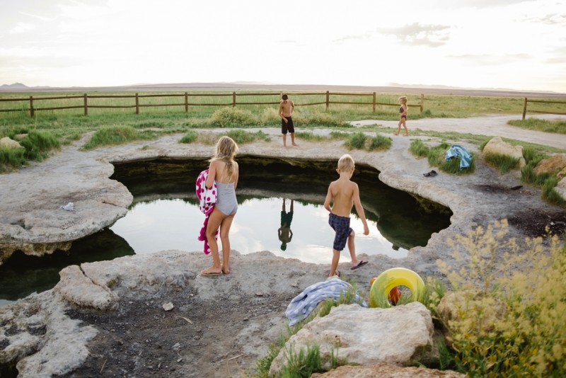 Children-get-ready-to-jump-in-swimming-hole-by-Summer-Murdock