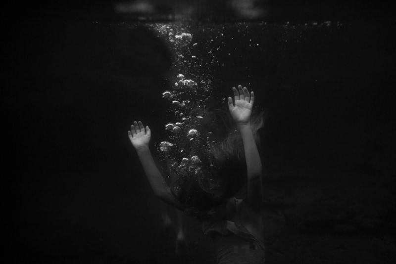 Image-of-bubbles-rising-from-child-underwater-by-Summer-Murdock