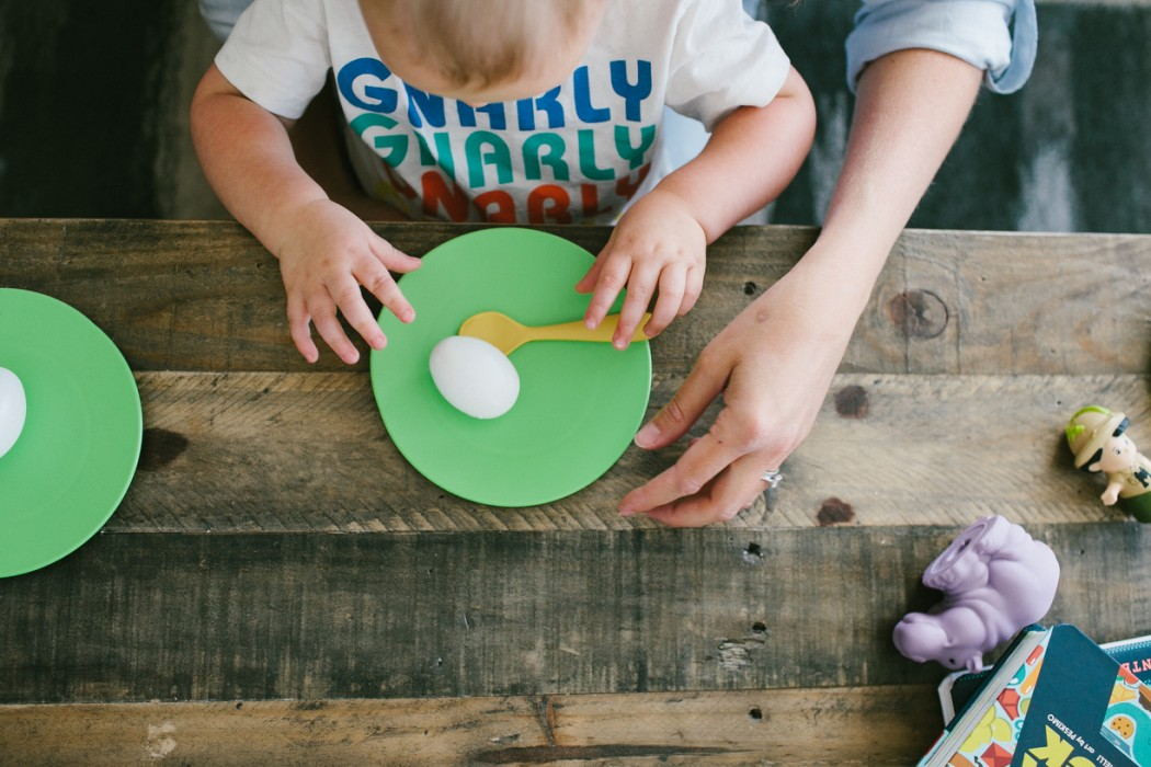 a photo of a child eating breakfast by kansas city photographer we are the parsons