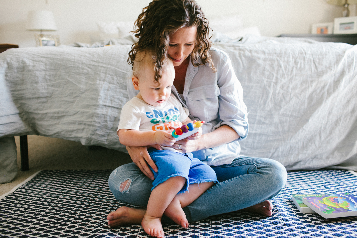 a photo of a mom cuddling her baby boy by kansas city photographer we are the parsons