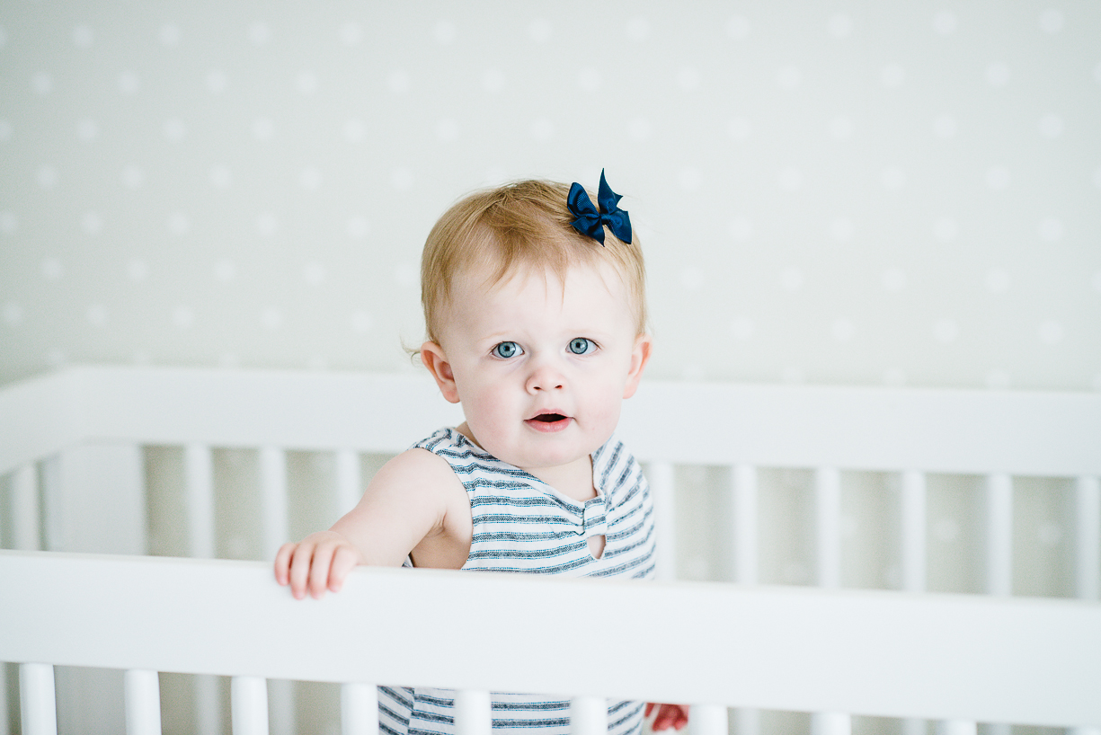 a photo of a toddler in her crib by boston photographer laura leibowitz