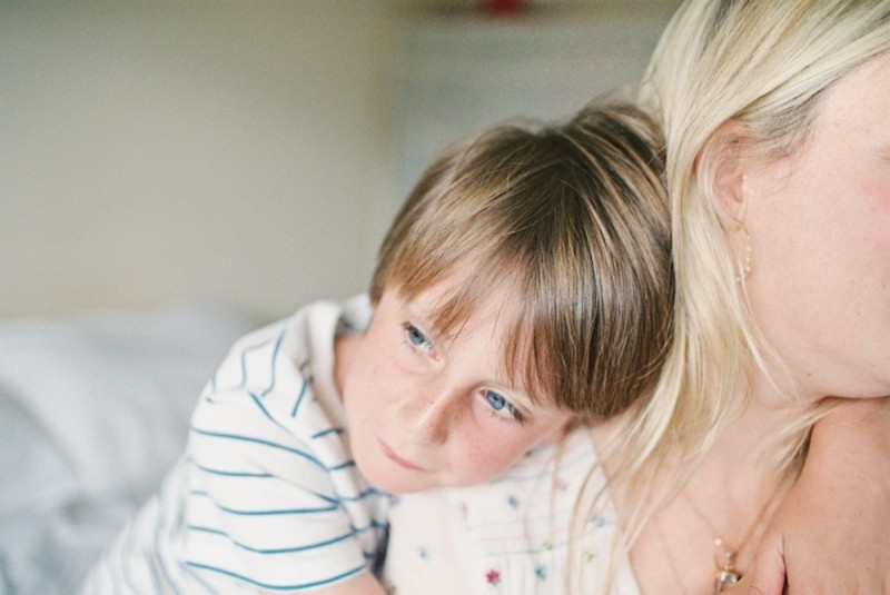 boy leaning on mom photo by kjrsten madsen