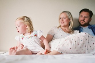 cute family on bed at home photo by photographer kjrsten madsen