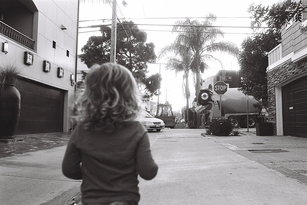 pic of little girl watching a cement truck by Simply by Suzy