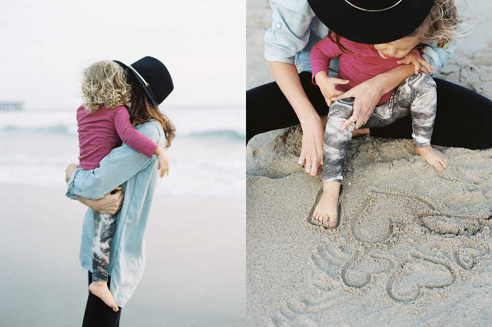 picture of little girl and mom playing in sand by Simply by Suzy