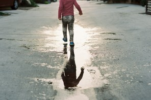 picture of little girls reflection in water by Simply by Suzy