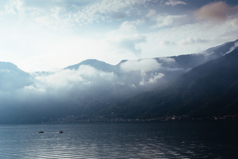 16 Small boats under cloud cover on Lake Como Italy by Darcy Troutman Photography