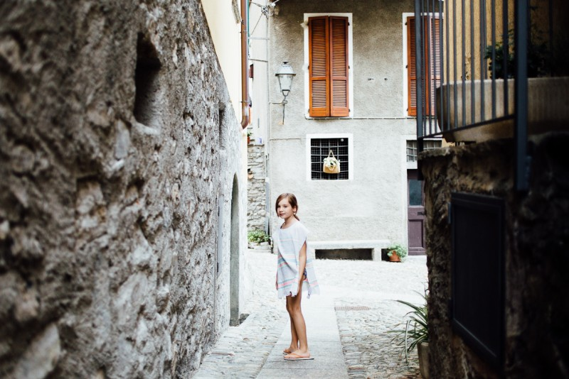 2 Girl on side street near Lake Como in Italy by Darcy Troutman Photography