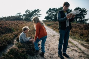 3 Family on hike while man reads map by Cocoa Jones Photography