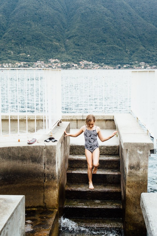 4 girl walks down steps into Lake como by Darcy Troutman Photography