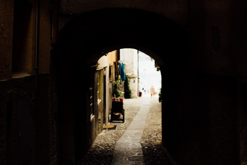 5 Side street in Italy through archway by Darcy Troutman Photography