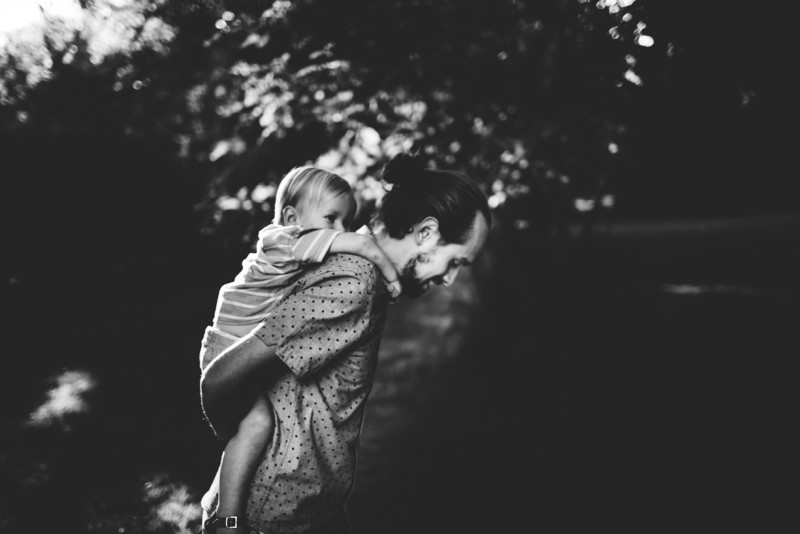 photo of father giving son piggy back ride black and white by Dannie Melissa Wit Abeille Photography