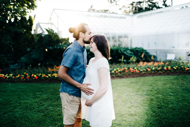 photo of husband kissing pregnant wife forehead holding belly by Dannie Melissa Wit Abeille Photography