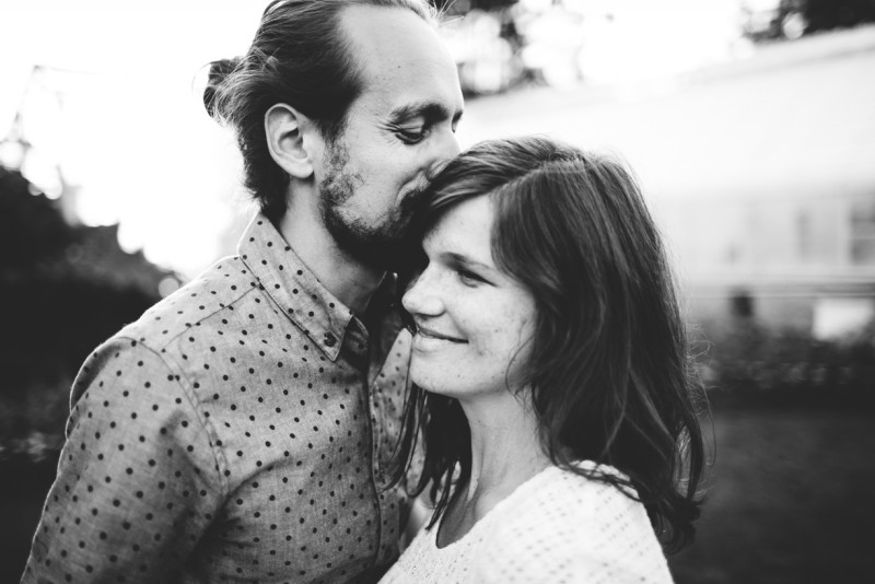 image of husband and wife close up black and white smiling by Dannie Melissa Wit Abeille Photography