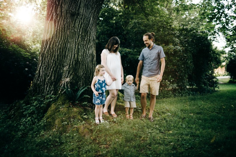 picture of family of four holding hands next to tree By Dannie Melissa Bit Abeille Photgoraphr