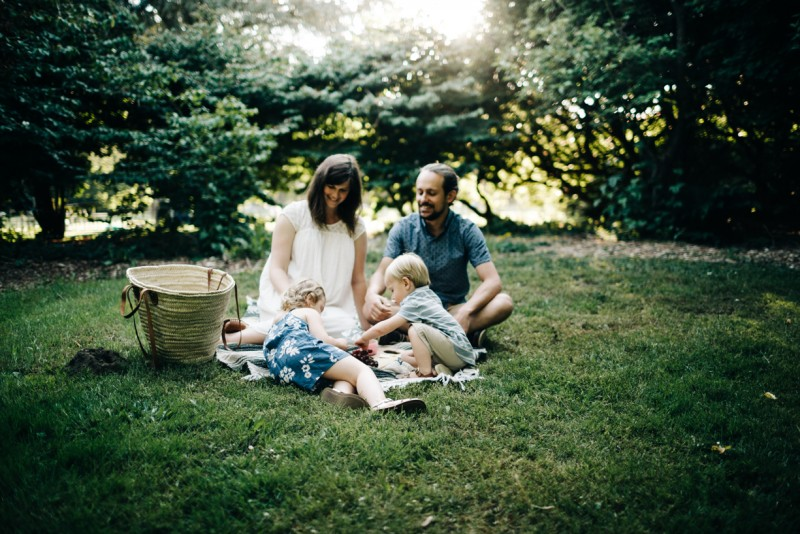 photo of family of four on blanket picnic park by Dannie Melissa Wit Abeille Photography
