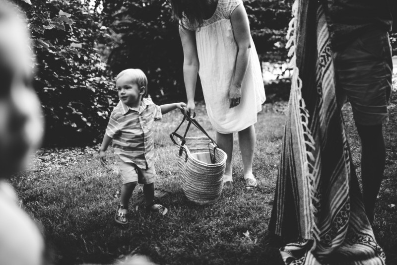 image of son helping family set up for picnic black and white by Dannie Melissa Wit Abeille Photography