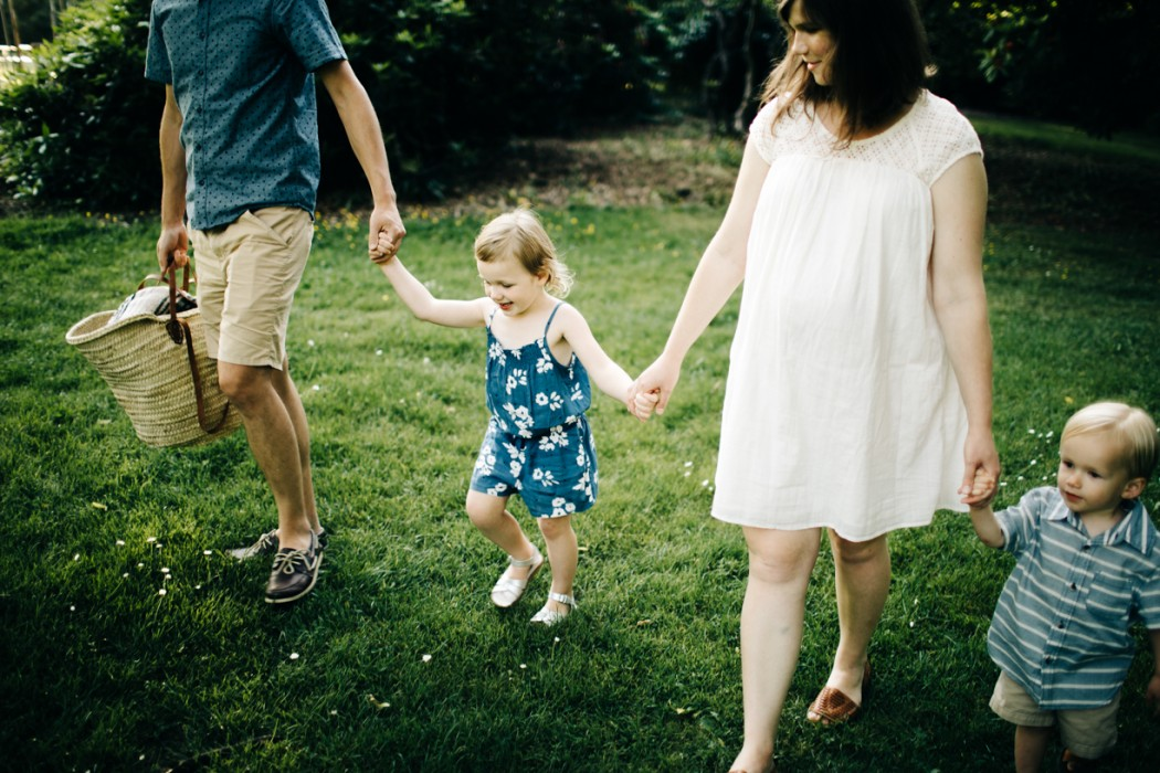 photo of family of four holding hands by Dannie Melissa Wit Abeille Photography