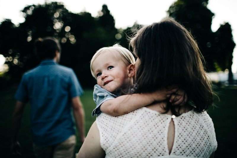 photo of mother holding son father walking ahead by Dannie Melissa Wit Abeille Photography