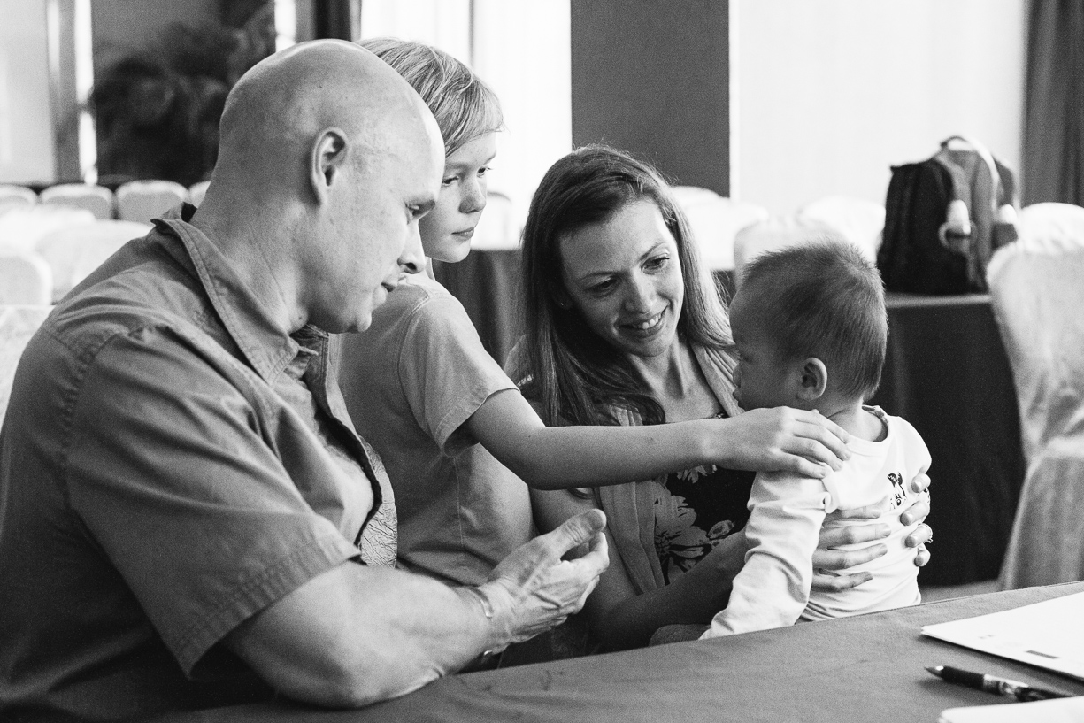 a family bonds with their new son in this photo on his adoption day in china by christine keegan