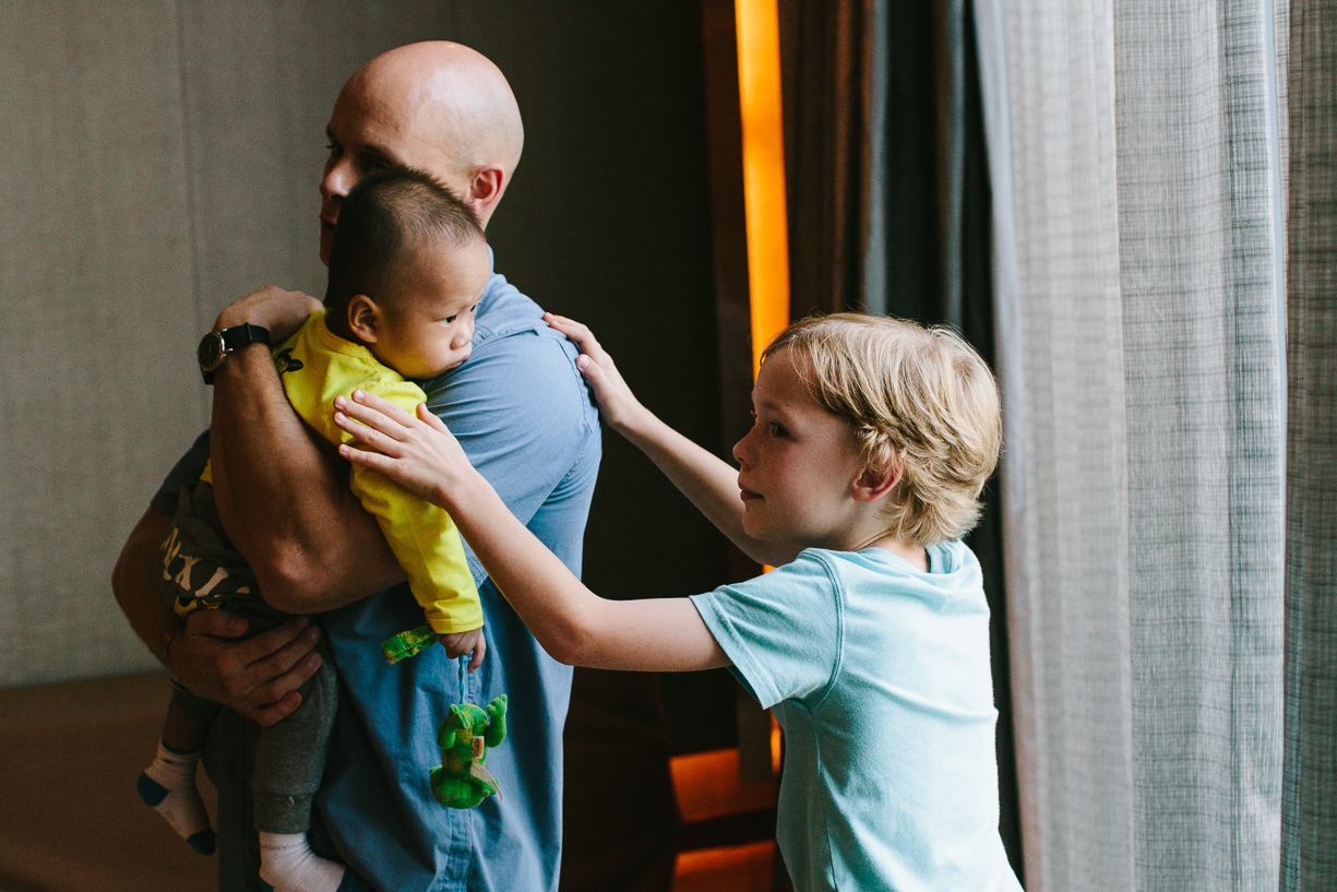 a picture of new brothers bonding on adoption day in china by christine keegan