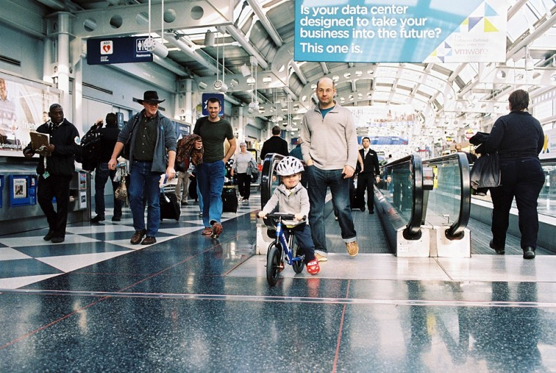 little boy on bicycle at airport photo by jess rotenberg