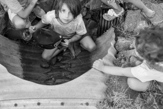 08_Children play in a drainage culvert by Stacie Ann Smith_Adventurer_Colorado