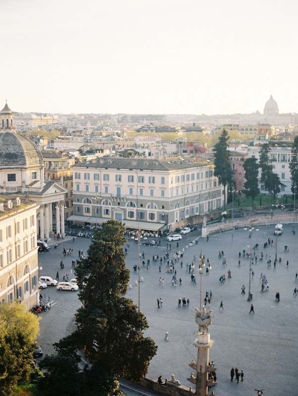 20 People walk amongst a square in Europe By Jacquelyn Hayward