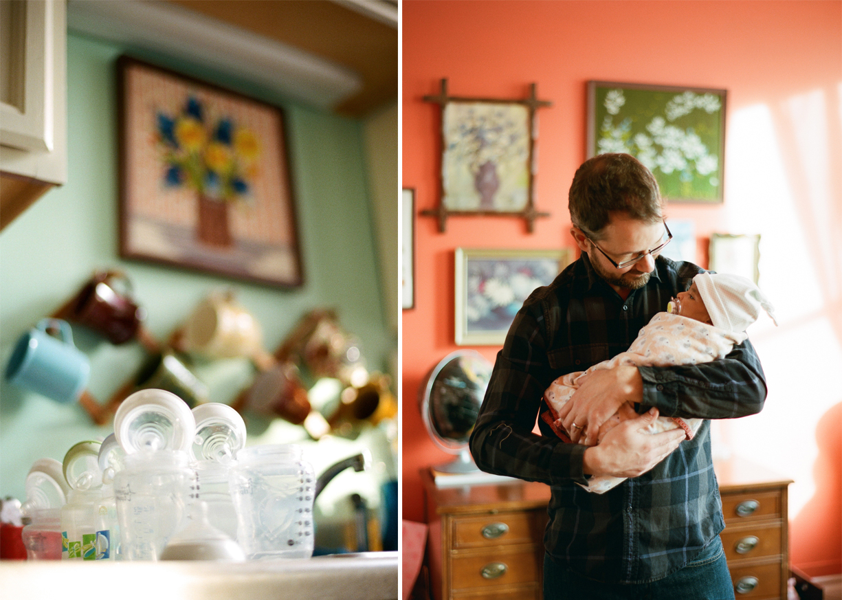 a picture of a father holding his newborn baby by photographer Shelly Goodman