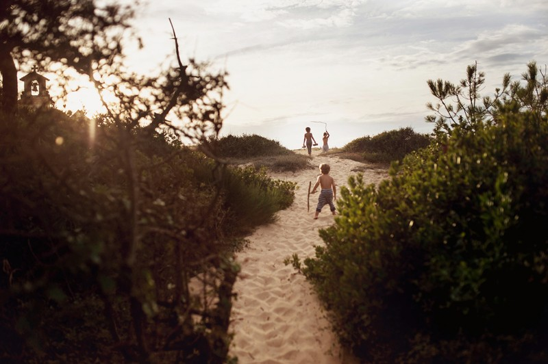 3 boys running on a sand path by Nadia Stone