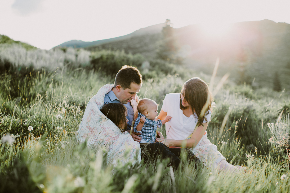 a backlit photo of a family in the grass by kandice breinholt of utah