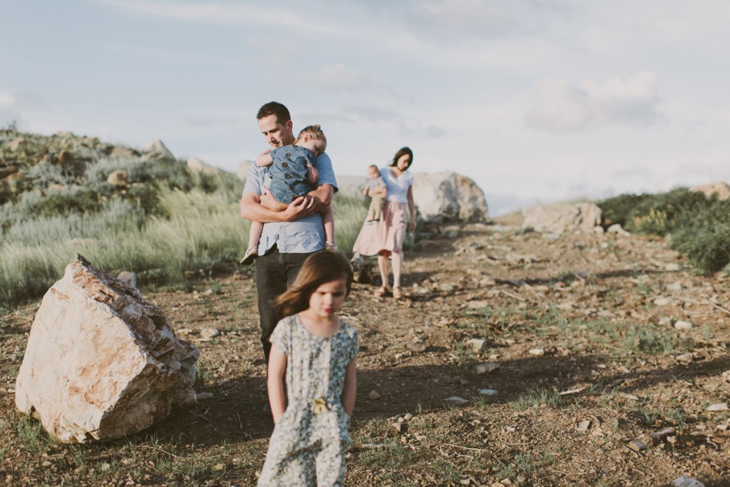 a photo of a family walking down a hill by utah photographer kandice breinholt