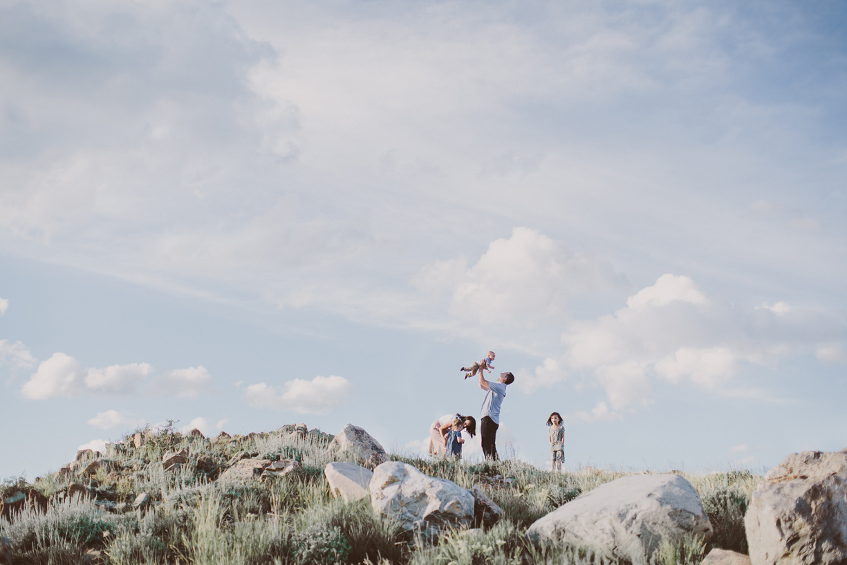 a picture of a family on a mountaintop by utah photographer kandice breinholt